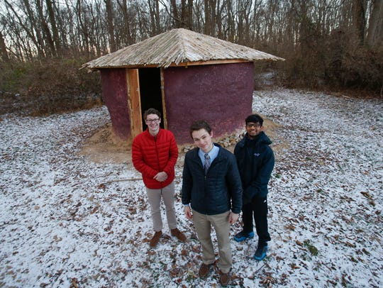 "From left, Steven Burns, Brennan Stark and Dhruv Mohnot at the earthen storage building they created on the grounds of the Siegel JCC in 2016. The group has since abandoned cob construction, and hope to build a ""straw bale"" house for a homeless family in Wilmington."