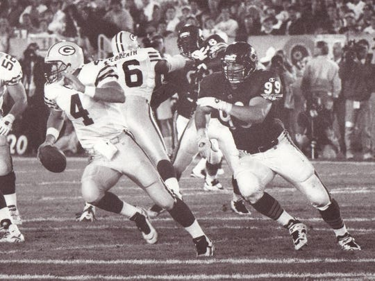 Former Chicago Bears defensive tackle Jim Flanigan chases legendary Green Bay Packers quarterback Brett Favre during a Monday night game in 1995.
