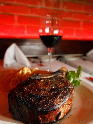 Jeff Ruby hosts a steak dinner benefit for the family of Officer Sonny Kim at The Precinct on Monday.