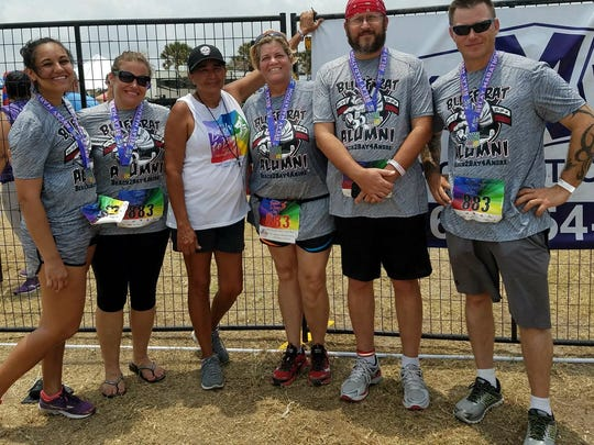 Bluff Rat Alumni 2017 Beach2Bay4Andre poses for a photo with Andre Fuqua's mother, Sheila, after finishing the 42nd annual Beach to Bay Relay on May 20, 2017. From left: Krista Torralva, Amber Ruddick, Sheila Fuqua, Terri Thompson, Gary Frontera and James Walker. Not pictured: Troy Stuart.