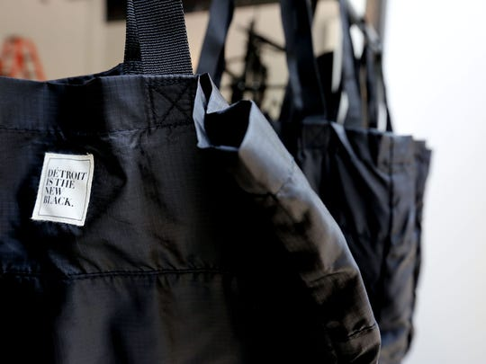 Roslyn Karamoko, founder of Detroit Is the New Black (DITNB), is opening a pop up store  at 1426 Woodward  in downtown Detroit this week that will have her T-shirt line and other items including these bags with  DITNB on them.  Also being featured are dresses by designer Tracy Reese who is a Detroit native.