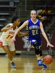 Memorial's Ryleigh Anslinger (20) drives down the court