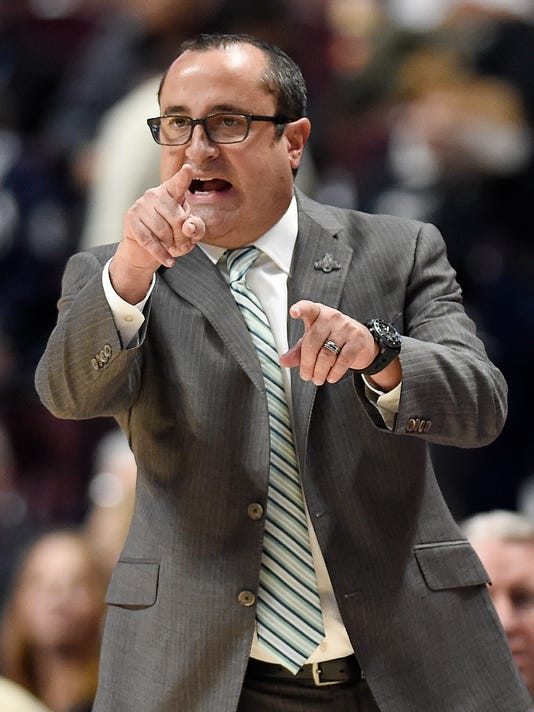 South Florida head coach Jose Fernandez gestures during the second half of an NCAA college basketball game against Central Florida in the American Athletic Conference tournament semifinals at Mohegan Sun Arena, Monday, March 5, 2018, in Uncasville, Conn. (AP Photo/Jessica Hill)