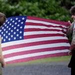 Members of the Boy Scouts Troop 7038 hold an American flag at Elks Lodge in Independence on Flag Day, June 14, 2011.
