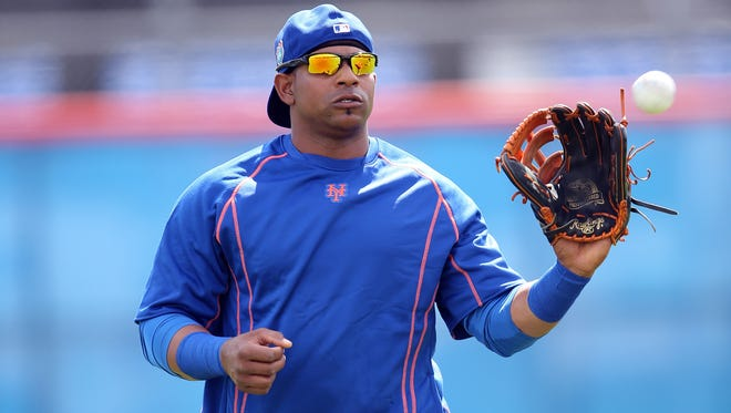 Feb 22, 2016; Port St. Lucie, FL, USA; New York Mets left fielder Yoenis Cespedes (52) warms up during spring training work out drills at Tradition Field.