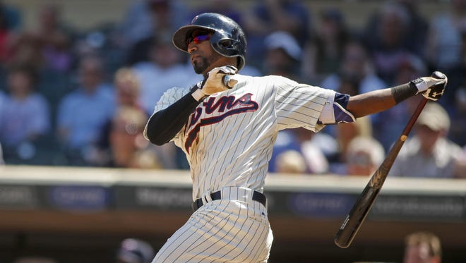 Minnesota Twins shortstop Eduardo Nunez (9) hits a three-run home run against the Toronto Blue Jays in the eighth inning Saturday at Target Field in Minneapolis.
