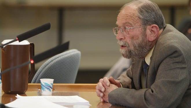 Jim Peach, professor of economics at New Mexico State University, speaks to the Senate Finance Committee about energy outlooks and oil prices at the state Capitol on Wednesday.