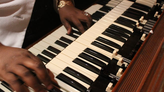 "Musician Sereca Robinson Henderson plays ""You Are My Sunshine"" on the organ."