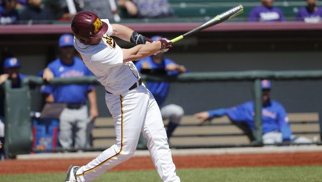 Rocori grad and Minnesota Gophers catcher Austin Athmann swings during a game this season.