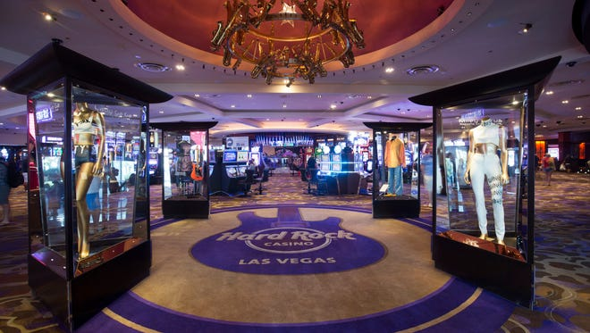 The entrance to the Hard Rock Hotel is flanked with musician memorabilia and a chandelier of saxophones.