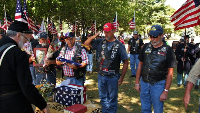 Patriot Guard Riders and Civil War reenactors participate in a ceremony for Pvt. Jewett Williams after his arrival in his home state of Maine.