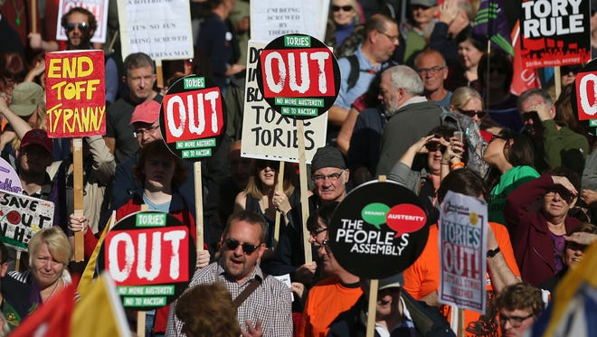 Anti-conservative protesters rally in Birmingham, central England, on Oct. 2, 2016 on the first day of the Conservative party annual conference, discussing how and when it will take the country out of the European Union following the Brexit vote.