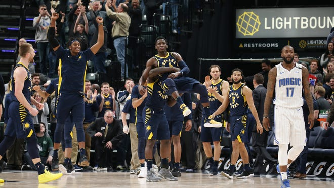 Jan 27, 2018; Indianapolis, IN, USA; Indiana Pacers guard Lance Stephenson (1) picks up guard Victor Oladipo (4) to celebrate as the Pacers react after the game to defeating the Orlando Magic at Bankers Life Fieldhouse. Mandatory Credit: Brian Spurlock-USA TODAY Sports