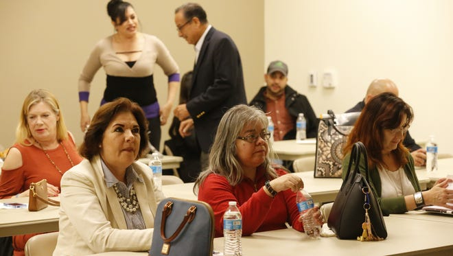 Maria Isaac, left, and Delia Osorto were among the East Side residents who gathered Tuesday night at the El Paso County East Side Annex to watch the State of the Union address by President Donald Trump.