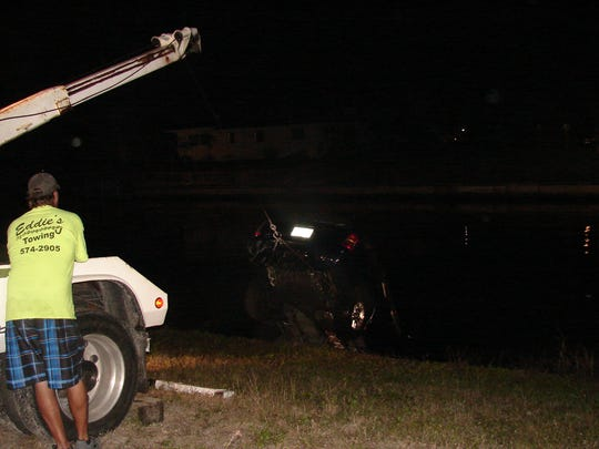 A man is rescued from a car after crashing into  a Cape Coral canal.