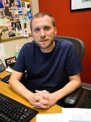 Robert Detmeringis associate professor and Information
