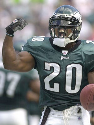Philadelphia Eagles saftey Brian Dawkins reacts after making an interception in the third quarter against the Houston Texans Sunday, Sept. 29, 2002 in Philadelphia.