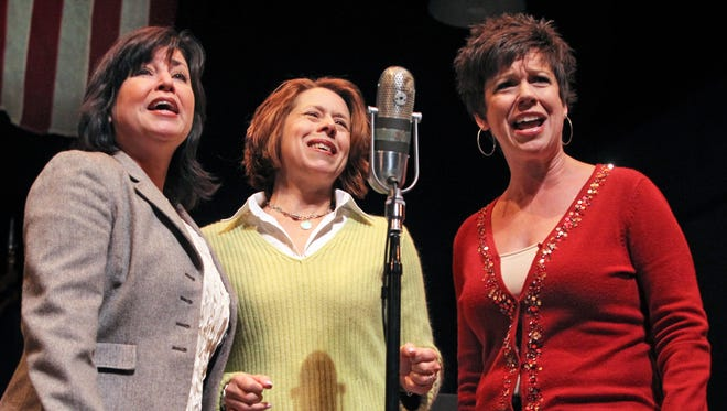 """The """"Andrews Sisters,"""" portrayed by, from left, Judy Fitzgerald, Cynthia Collins and Holly Stults of the Actors Theatre of Indiana, sing """"Boogie Woogie Bugle Boy"""" for the crowd gathered in Carmel's Tarkington Theater for the city's Veterans Day ceremony on Friday, Nov. 8, 2013. Actors Theatre of Indiana will perform the first show for the grand reopening of the main stage at the newly named District Theatre."""
