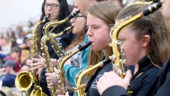 "Saxophonists perform as part of the pep band for Stuarts Draft High School rock their gymnasium performing Jason Derulo's ""Trumpets."" They perform before the start of their boys' home basketball game against Wilson Memorial, played in Stuarts Draft on Tuesday, Jan. 3, 2017."