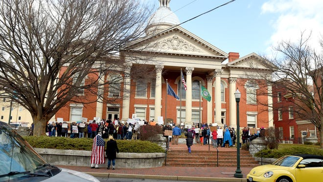 Around 150 people attended an immigration policy protest, holding signs and chanting, in front of the Augusta County Courthouse in downtown Staunton on Monday, Jan. 30, 2017.