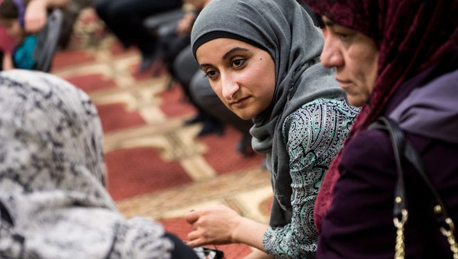 Kasar Abdulla, center, helps translate during a meeting about President Donald Trump's travel ban at the Salahadeen Center in Nashville on Feb. 4, 2017.