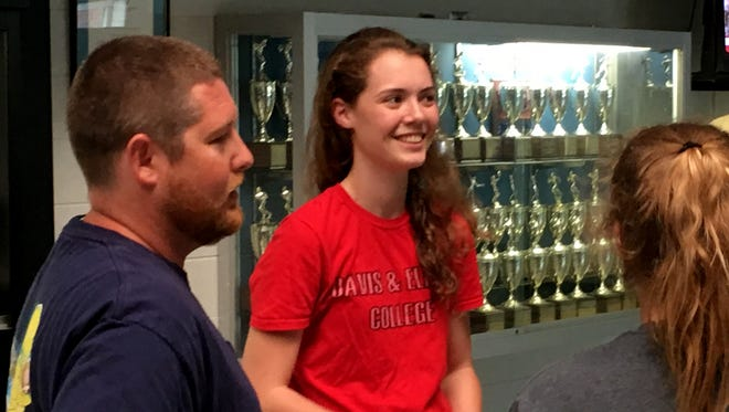 Fort Defiance's Faith Farley, center, talks with her coach, Patrick Hartley, and others before her ceremony to sign with Davis & Elkins College Tuesday afternoon.