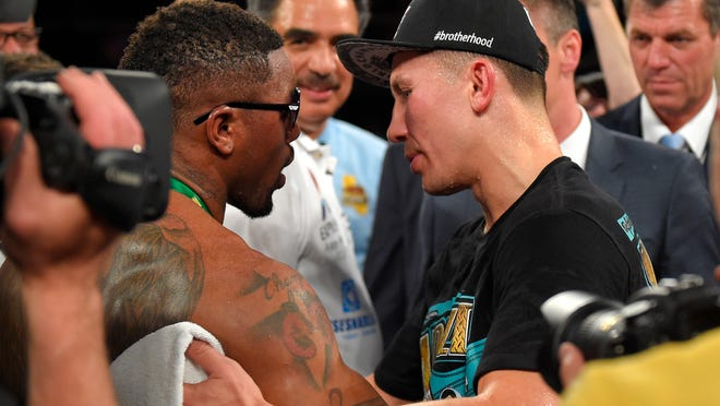 Gennady Golovkin, right, of Kazakhstan, hugs Willie Monroe Jr. after their a middleweight world championship bout, Saturday in Inglewood, California. Golovkin won by TKO after the fight was stopped in the sixth round.