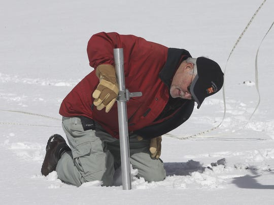 In this photo from the past, Frank Gehrke checks the snowpack depth while performing a snow survey at Phillips Station near Echo Summit.