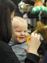 A mother and her infant child look at toys at one of several vendor booths Friday morning during the Junior League of Wichita Falls annual Christmas Magic event held at the Multi-Purpose Event Center. Christmas Magic continues Sunday from 12 p.m. to 5p.m. Tickets and be purchased at the door.