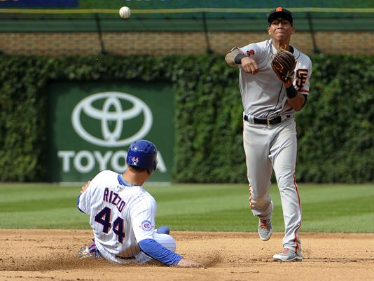 San Francisco Giants shortstop Ehire Adrianza, right, forces out Chicago Cubs' Anthony Rizzo (44) at second base during the sixth inning of a baseball game, Sunday, Sept. 4, 2016, in Chicago. (AP Photo/David Banks)