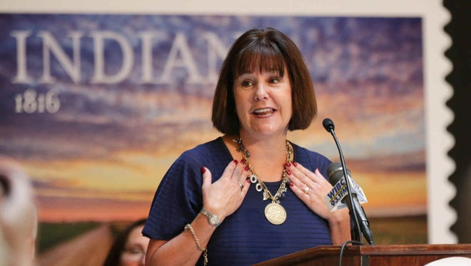 First Lady of Indiana Karen Pence shows off her new Indiana bicentennial necklace during the 1816 Commemorative Forever Stamp First-Day-Of-Issue Stamp Dedication Ceremony, celebrating Indiana's Bicentennial, held at the Indiana Statehouse, Tuesday June 7th, 2016. The photograph appearing on the stamp was taken by Michael Matti and designed by Derry Noyes.