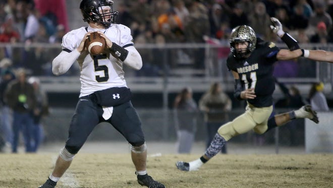 Wayne County's Preston Rice (5) looks to pass against Dresden during the Class 1A semifinals at Rotary Field in Dresden, Tenn., on Friday, Nov. 25, 2016.