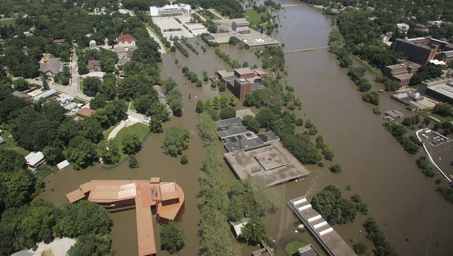 Floodwaters from the Iowa River surround the University of Iowa's art building, bottom left, and the Museum of Art, center right,  in Iowa City June 16, 2008.
