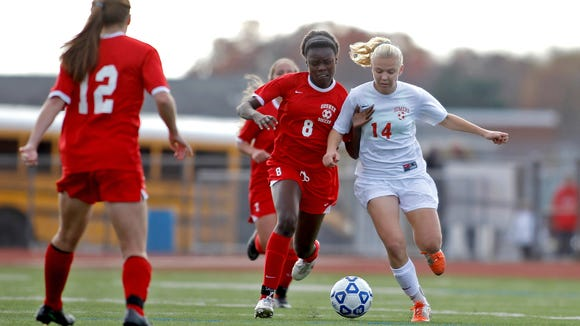 Somers' Melina Couzis (14) fights for possession during their 1-0 win over Goshen in the girls Class A regional final at Arlington High School in Arlington Nov. 9, 2014.