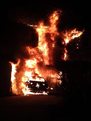 Car and house engulfed in flames at 245 Union Ave. in Mount Vernon early Sunday morning.