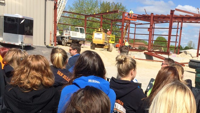Seniors from Reedsville High School view a Lorrigan Construction job site. Faced with a shortage of skilled workers, Bill Lorrigan Construction, Inc., held an information tour to expose students to opportunities in the construction field.