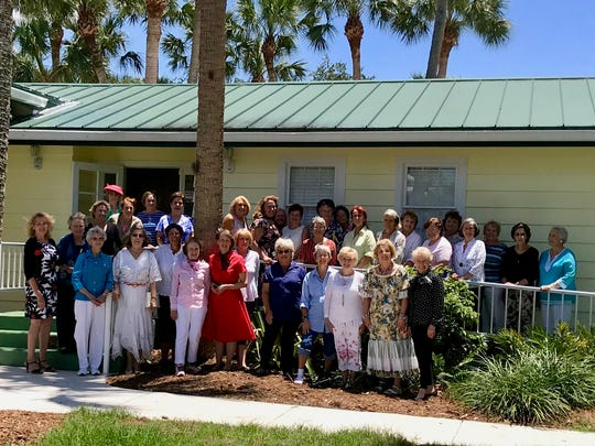 Members of the Garden Club of Fort Pierce gather forthe 70th anniversary celebration.