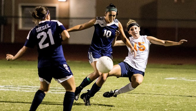 Blackman's Carly Bowen goes down while battling Siegel's Madison Louk for the ball earlier this season.