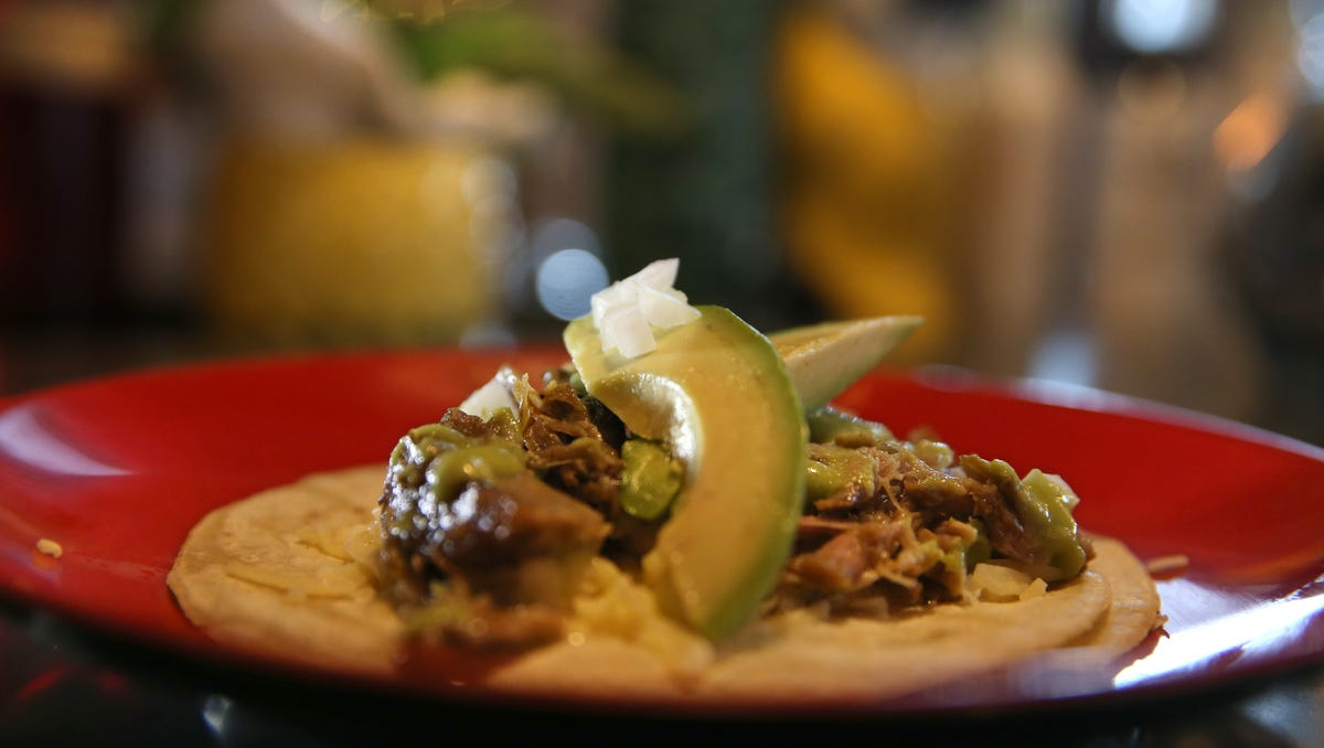 Carnitas tacos, with slow cooked pork shoulder, avocado and salsa verde, at Lulu.