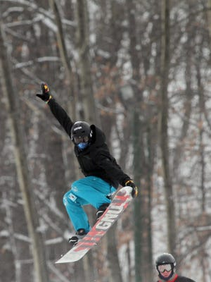 A snowboarder flies through the air at the Granite Peak Ski Area in Rib Mountain in November.