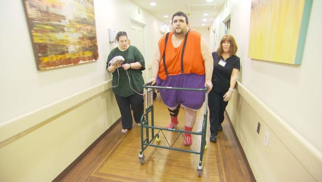 """Robert Buchel of Forked River walks with his fiancee,  Kathryn Lemanski of Manchester, on TLC's """"My 600-Lb Life."""""""