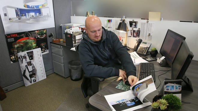 Jonathan Price of Walworth works on designing a new project at his desk.