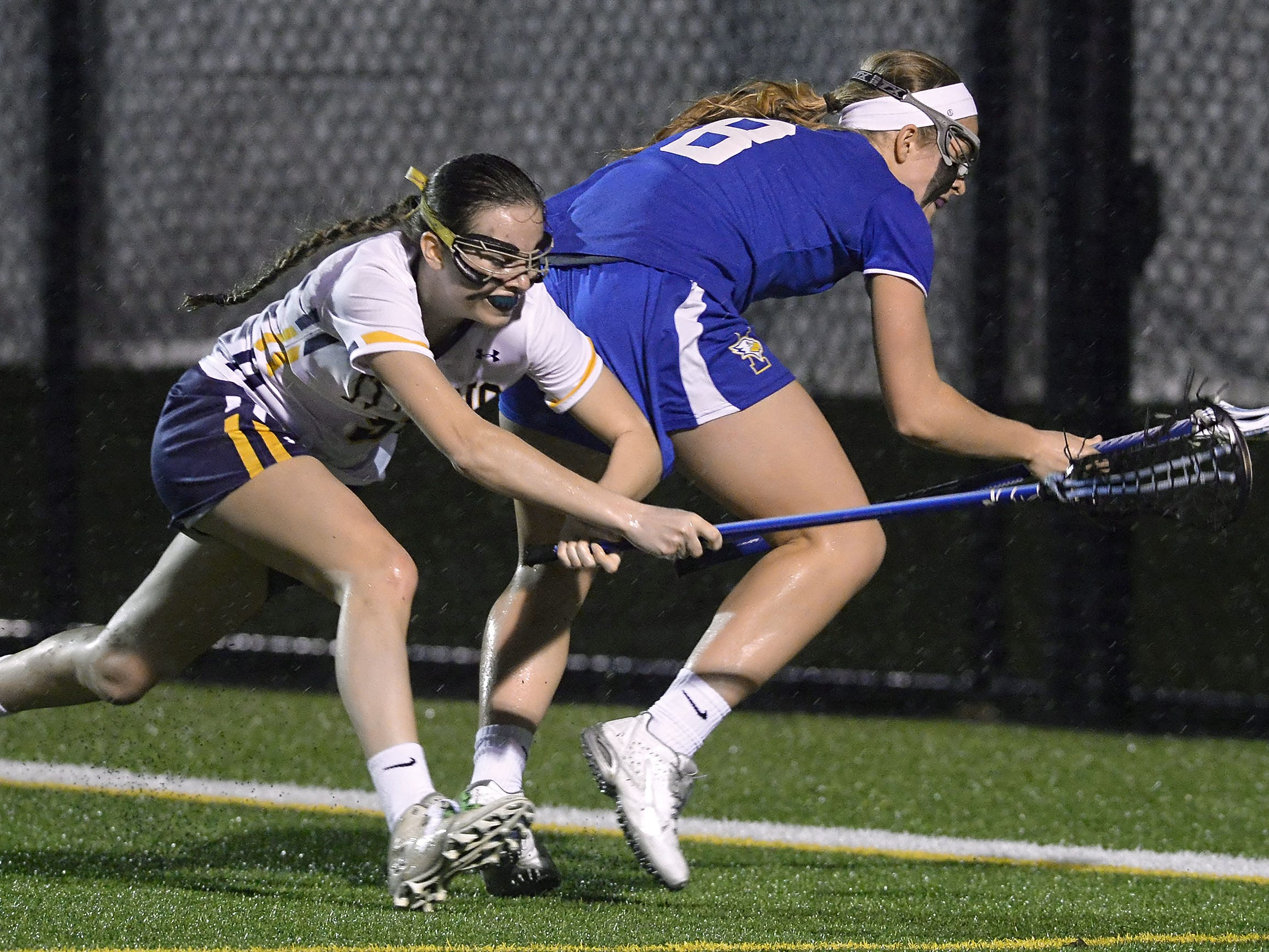 Webster Thomas' Marley Morrill, left, challenges Irondequoit's Jourdan Roemer for the ball.