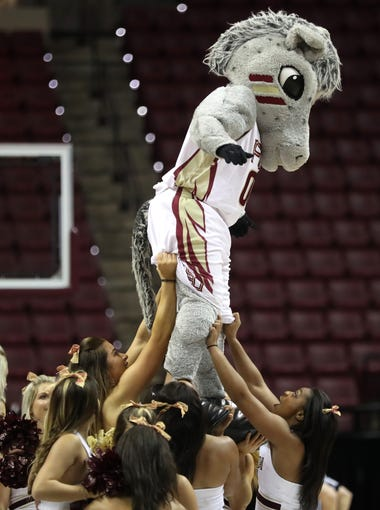 FSU's Cimarron performs with the cheerleaders during their game against Boston College at the Tucker Civic Center on Thursday, Feb. 22, 2018.