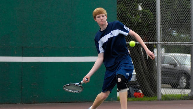 Marysville Vikings' Brenden Campbell returns a hit Monday in tennis action at Port Huron High.