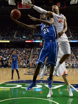 Duke's Amile Jefferson takes it up against Virginia's Akil Mitchell.