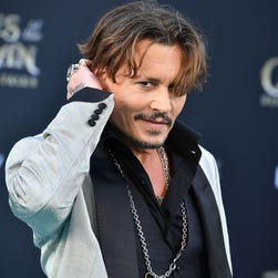 Johnny Depp jokes about assassinating Donald Trump at Glastonbury