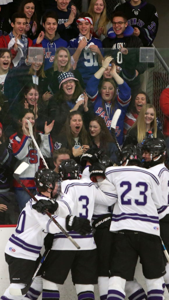 John Jay (CR) players celebrate with their fans after a goal against Greeley during the Section 1 boys hockey championship game at Brewster Ice Arena Feb. 24, 2018. John Jay won the game 5-3.