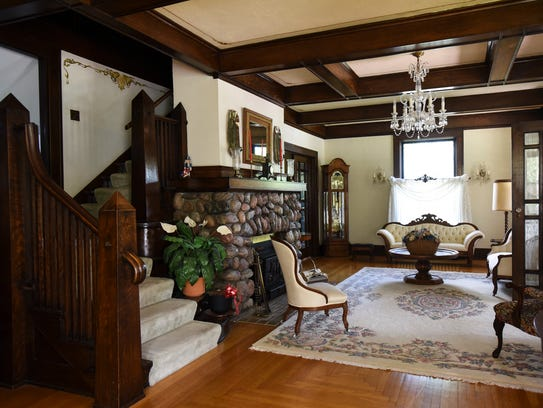 The front living room and staircase in the century-old