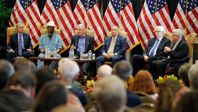 In this Monday, Sept. 12, 2016 photo, Donald Trump supporters from left, Chris Hart, radio personality, David A. Clarke Jr.,Sheriff of Milwaukee County, Wis., actor Jon Voight, radio personality's Mike Gallager, Dennis Prager, and Hugh Hewitt, take part in a town hall meeting with the Great American PAC in Lake Mary, Fla. The Great America PAC is rolling through battleground states, opening offices and registering voters. Presidential hopefuls often embark on bus tours to meet voters across the country. This time, a super PAC is standing in for Republican nominee Donald Trump.